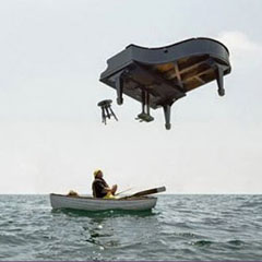 man in a boat under a falling piano