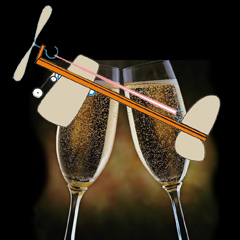 rubber band airplane over two champagne glasses